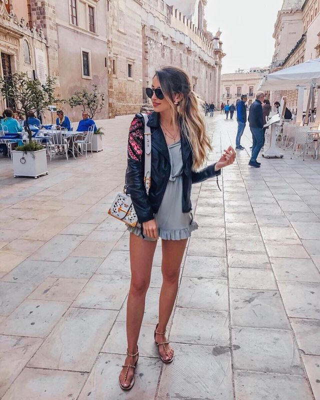 Summer club outfit with short romper and a leather jacket