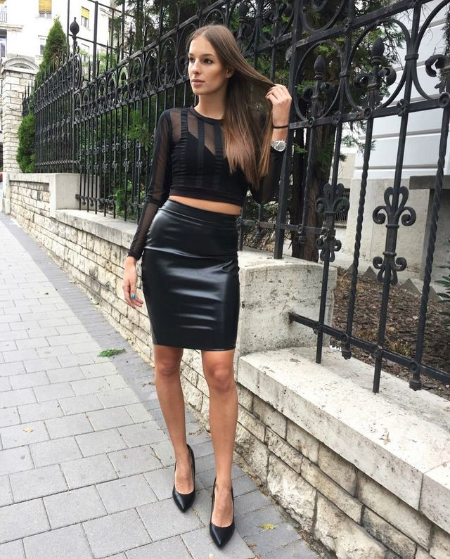 Stylish pairings of black leather skirt with a lace top