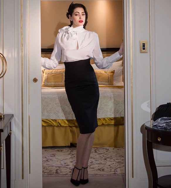 A high-waisted black pencil skirt that sits lower and a white shirt and stilettos