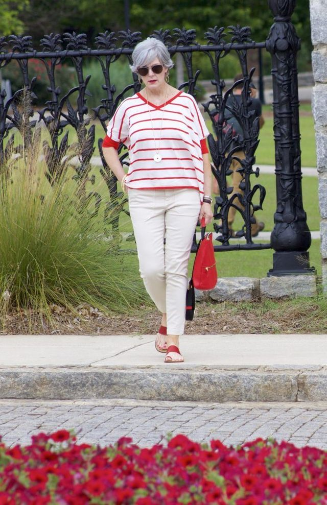 Neutral colored pants teamed up with a striped V-neck top can hide all imperfections, so you should include it in your collection of casual outfits for 50 year old woman