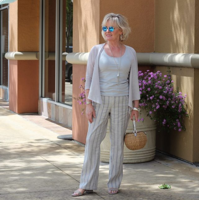 Spring casual outfits for 50 year old woman with an asymmetric cardigan