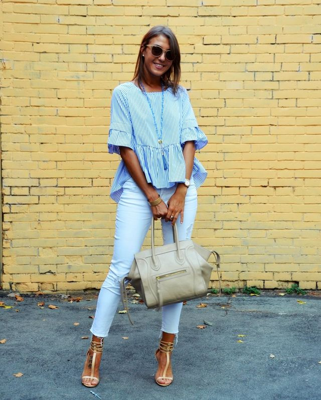 Summer outfit with white jeans, high heels and a large blouse