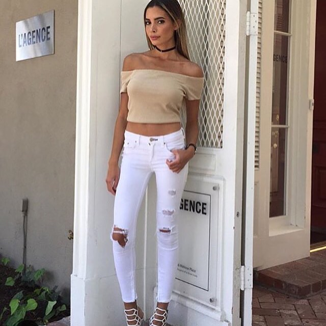 White jeans club outfit, white sandals with high heels and off shoulders top