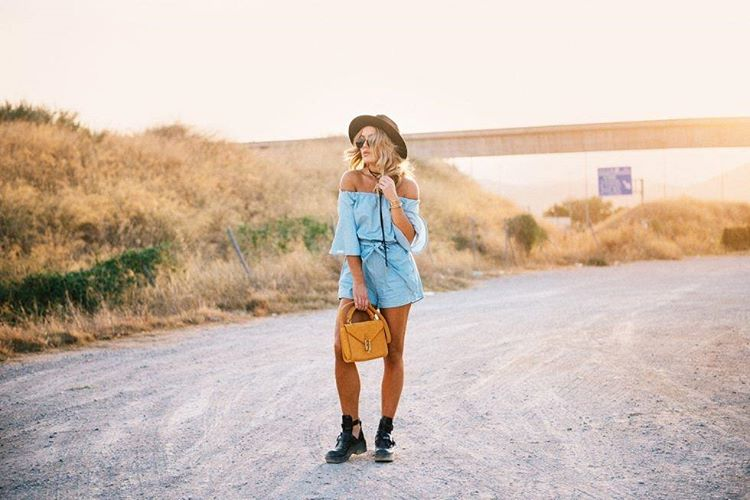 Denim romper outfit with boots