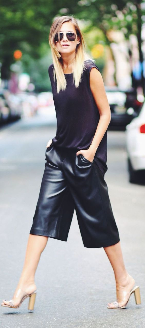 Black t-shirt sleeve less top and leather cropped pants