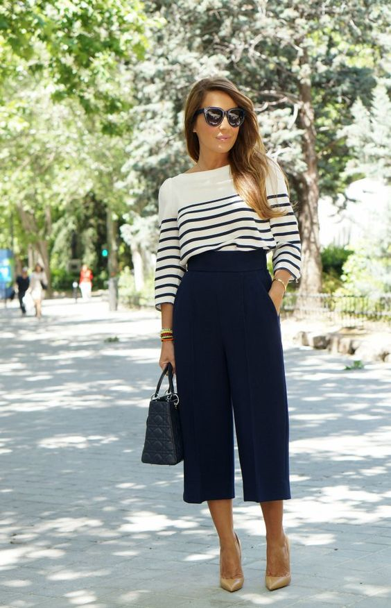 A white shirt with horizontal stripes paired with navy culottes