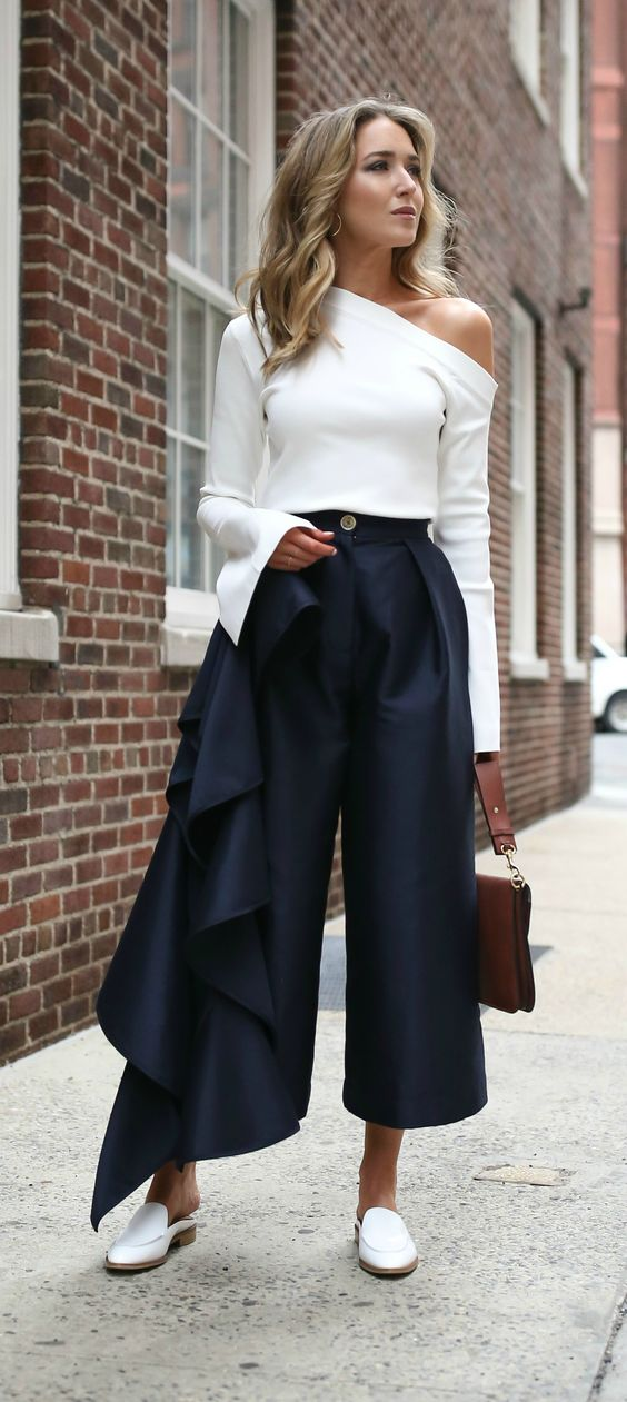 A mix between a nice long sleevs blouse with one shoulder exposed