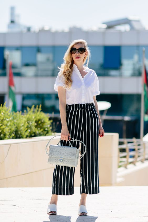 Vertical stripes cropped pants look majestic with a white shirt