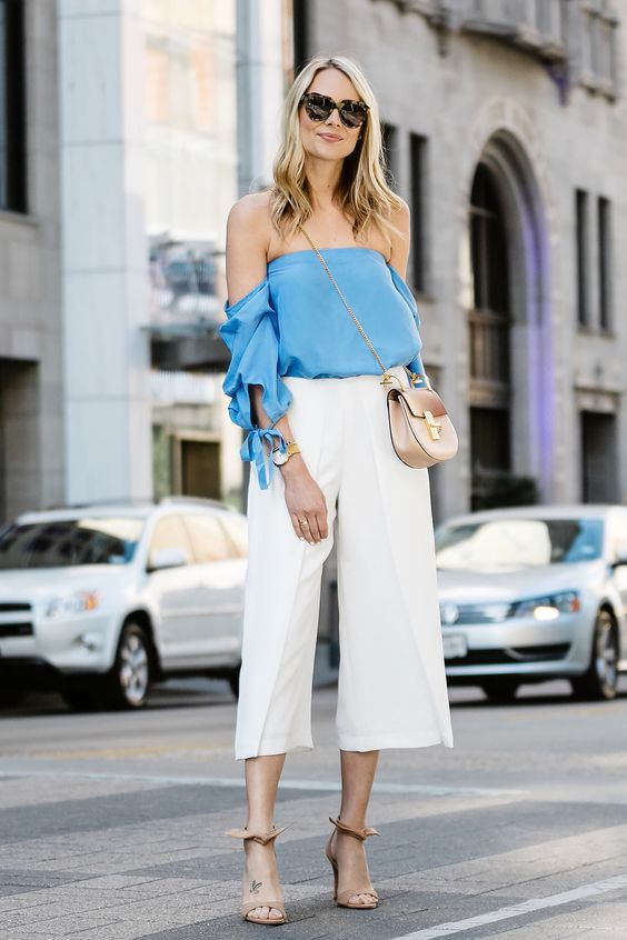 Off-shoulder tops when associated with white culottes create a modern and romantic effect