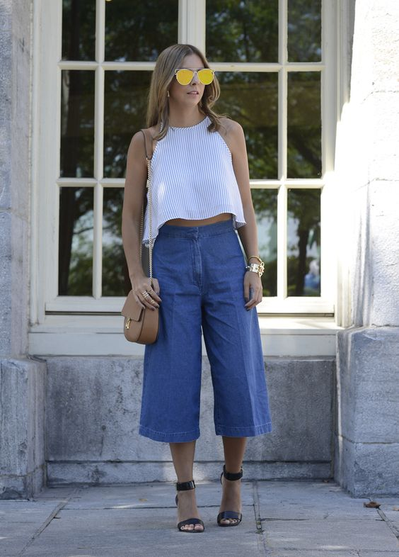 Go for a flirty cropped top teamed up with voguish denim culottes