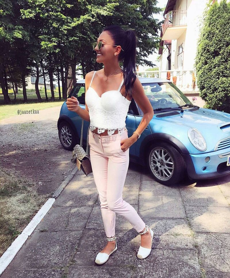 Light pink pants look fantastic with white lace bralettes for a colored club outfit without heels