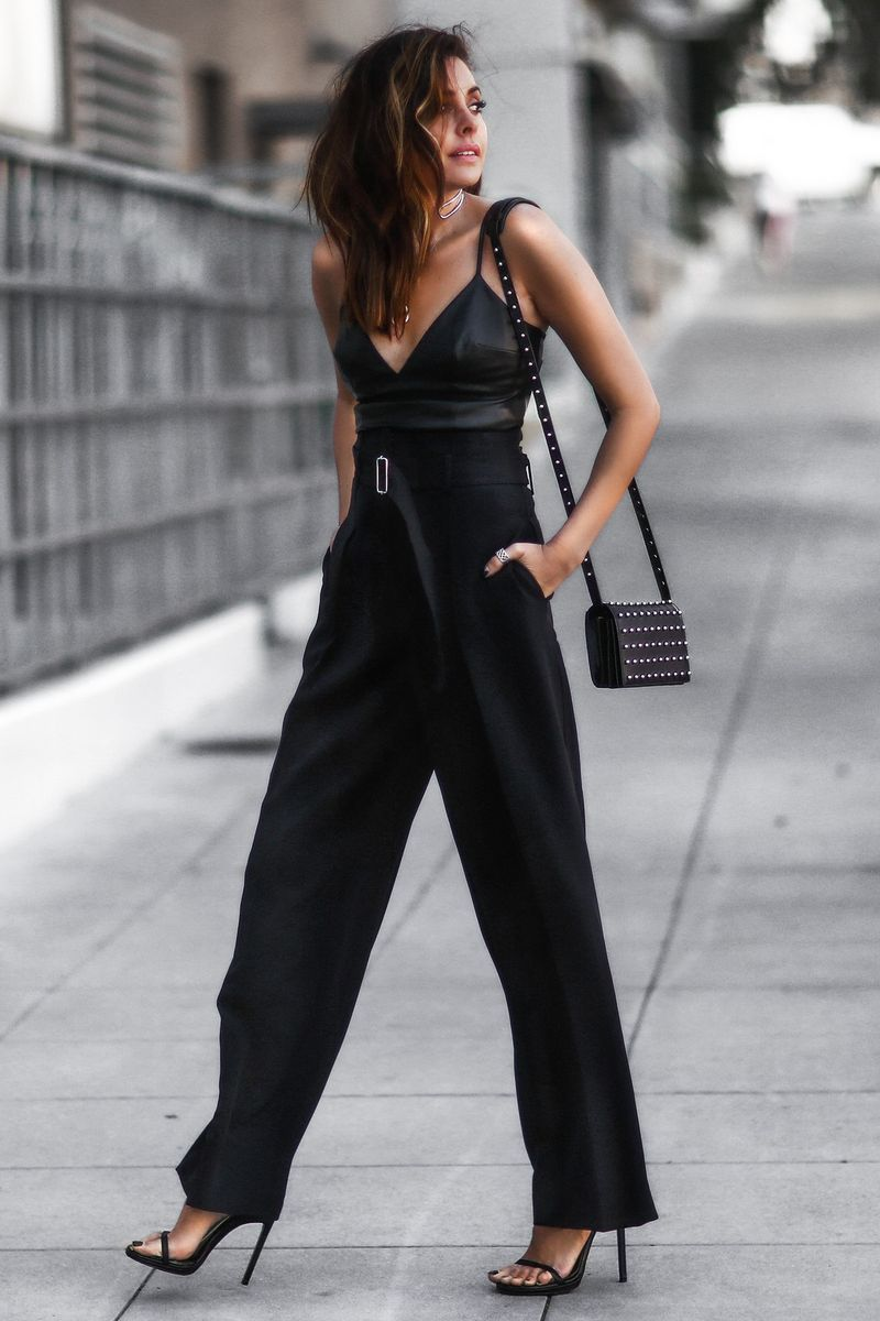 Sport a high-waist flared pants paired with a simple yet voguish faux leather bralette for a summer night out outfit