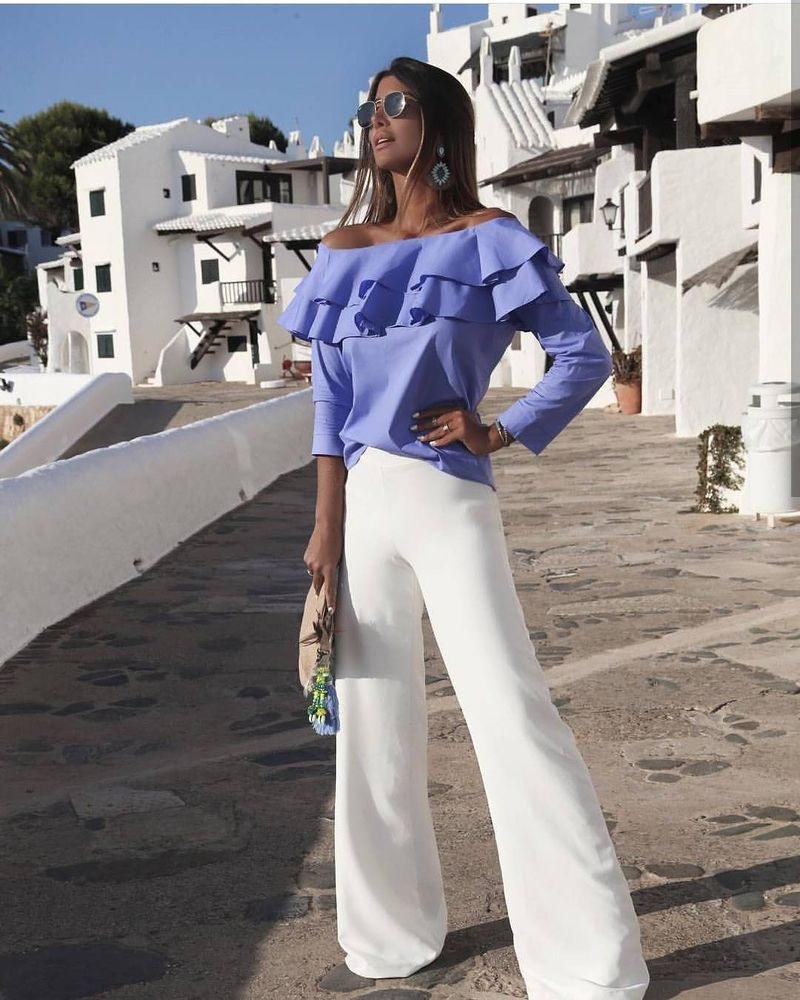 Ruffle dropped shoulder tops and flared white pants are best summer club outfits for women