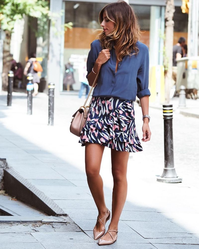 Summer going out outfit with a printed flowy skirt team up with a nice mono colored blue shirt