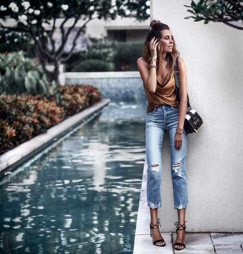 Bronze colored top and ripped jeans outfit for clubbing