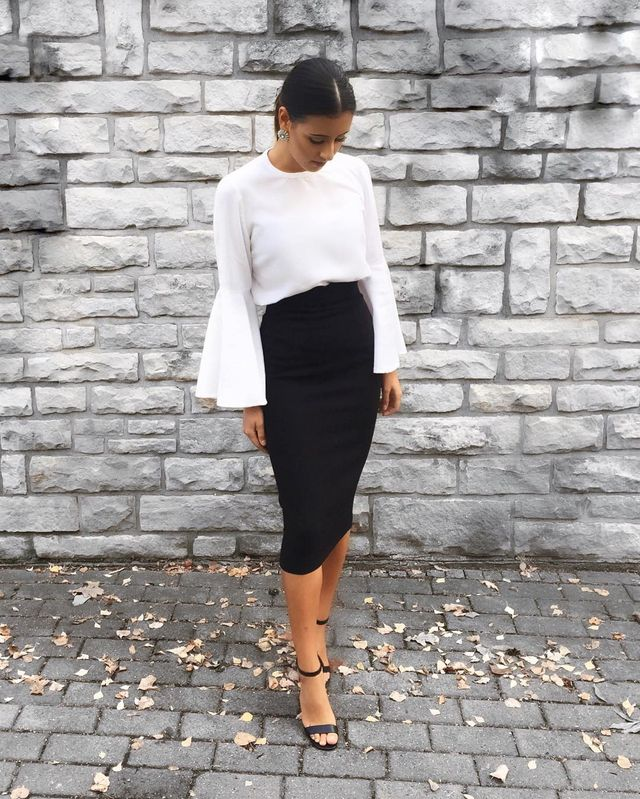 High-rising black pencil skirts look gorgeous both with short- or long-sleeve blouses like the one below