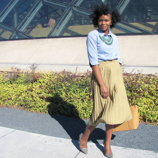 Summer casual work outfit with a plated skirt and a blue shirt