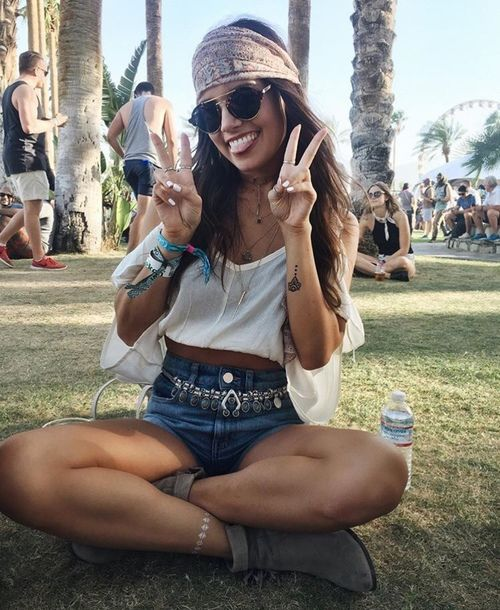 Summer festival outfits with a pair of denim shorts, a white off-shoulder top, ankle boots and eventually a cool bandana, retro chic sunnies