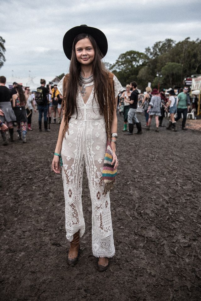 Old-time festivals outfit with boots, a hat and crochet bags