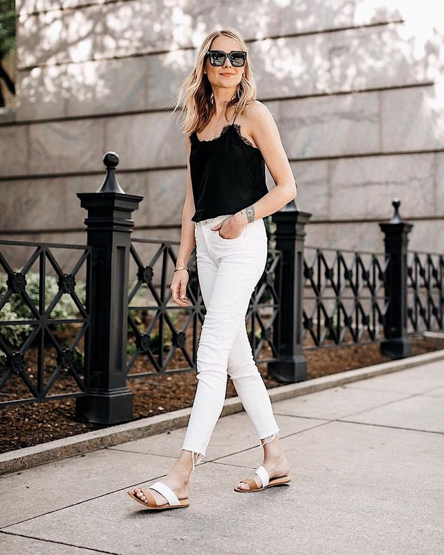 Flat shoes, white jeans and a small, tinny black blouse for casual summer outfits with jeans