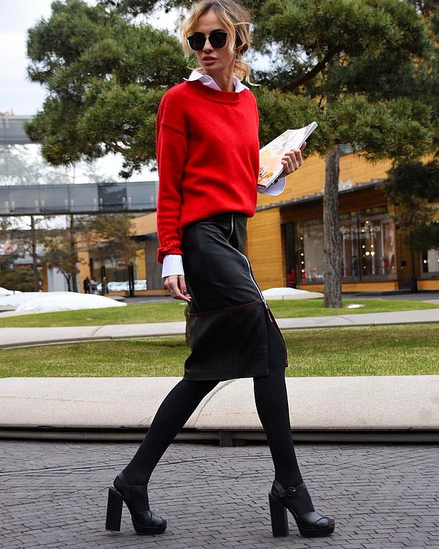 Cute black leather skirt outfit matched with a red sweater