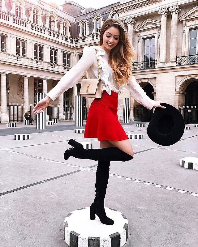 Red mini skirt outfit with high black boots