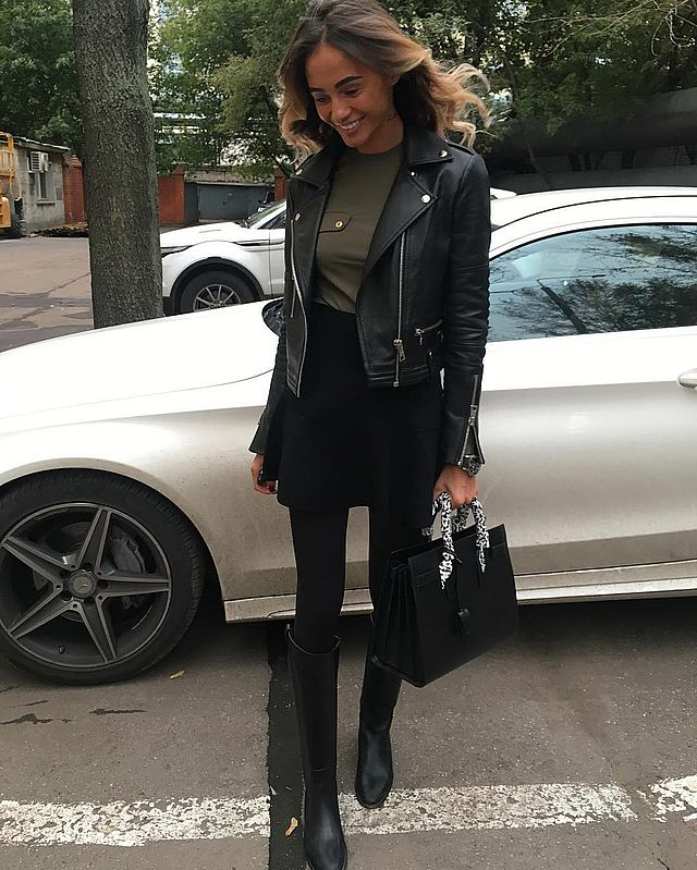 Black mini skirt outfit with boots