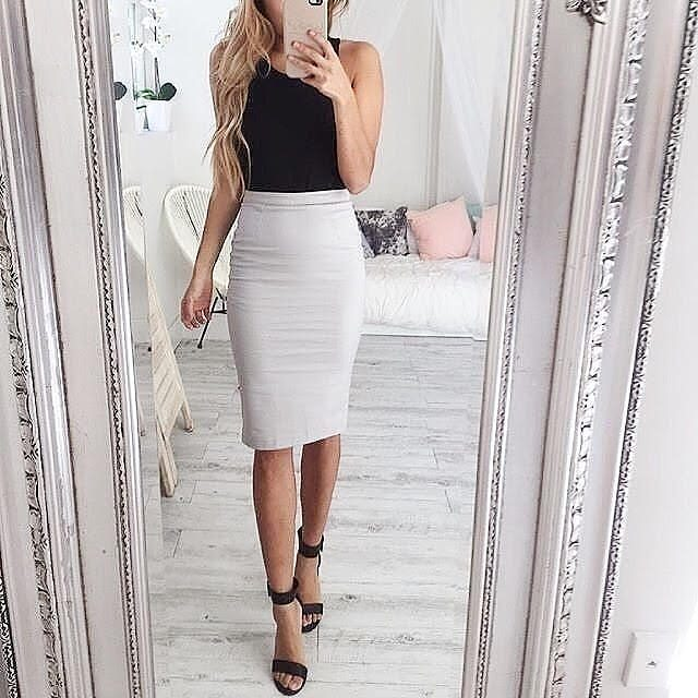 White pencil skirt outfit with sandals and a black tank