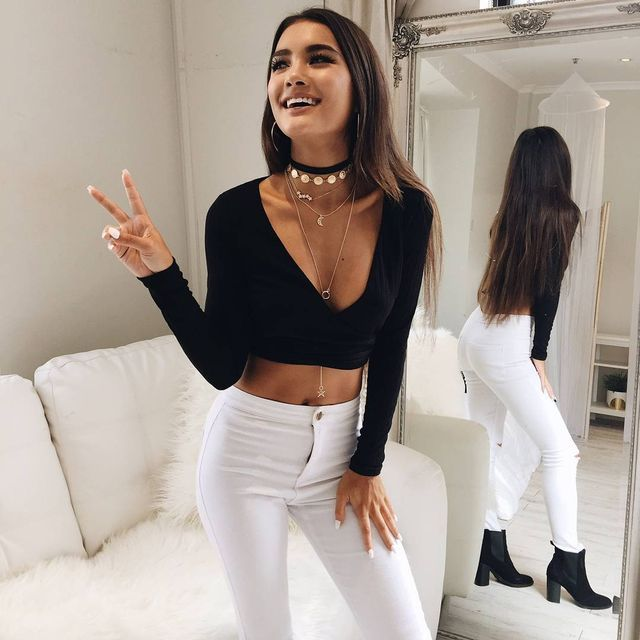Winter clubbing outfit with white pants, black cropped top and ankle boots