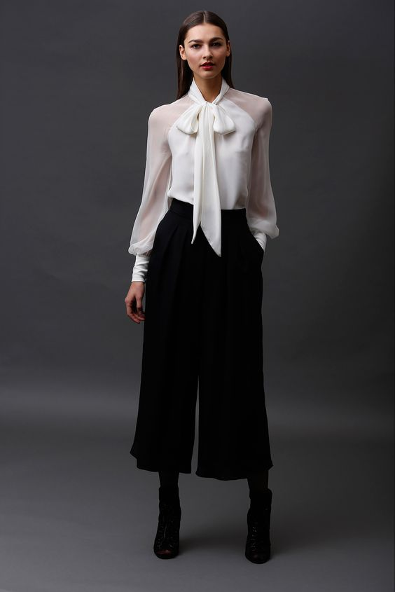 Elegant outfit with black culottes pants and high heels