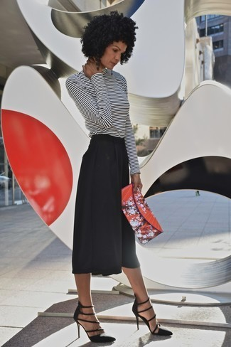 Black culotte pants with high heels and printed blouse