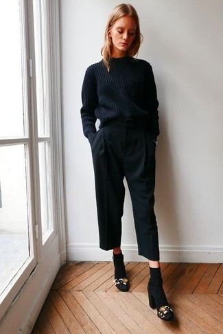 Culotte pants with short boots and a sweater for cold days