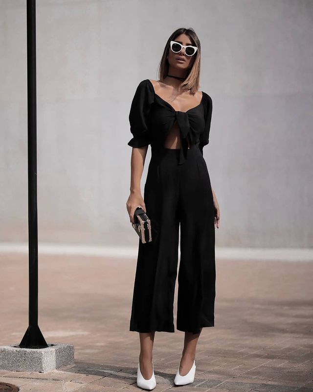 All black outfit with wide leg trousers and white shoes