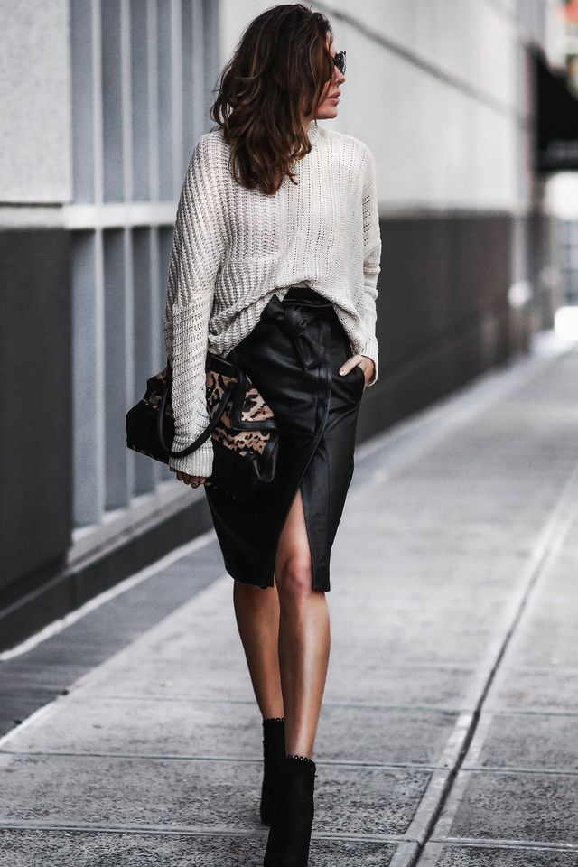 First date drinks outfit with a black leather skirt, a sweater and ankle boots