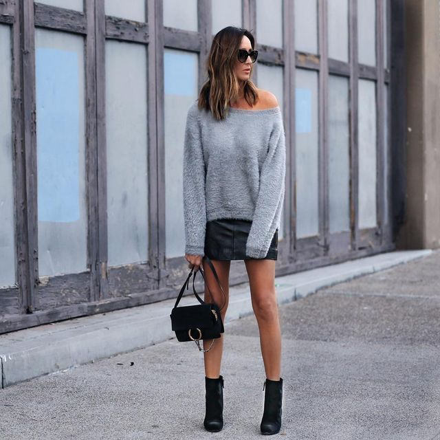 First date drinks outfit with a short black leather skirt and an oversized sweater