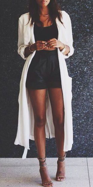 Shorts club outfit with leather pants and a white long cardigan