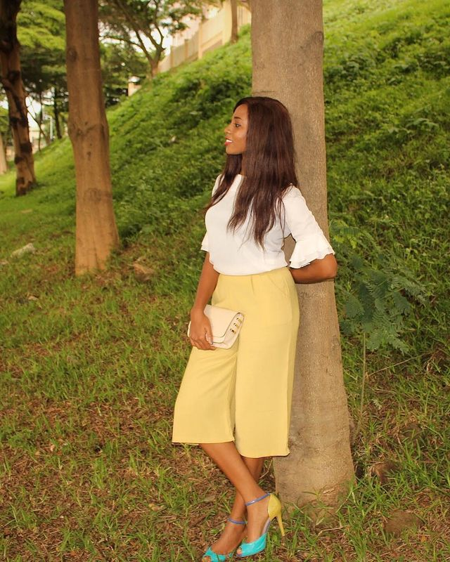 Add a nice elegant blouse to your yellow culottes outfit