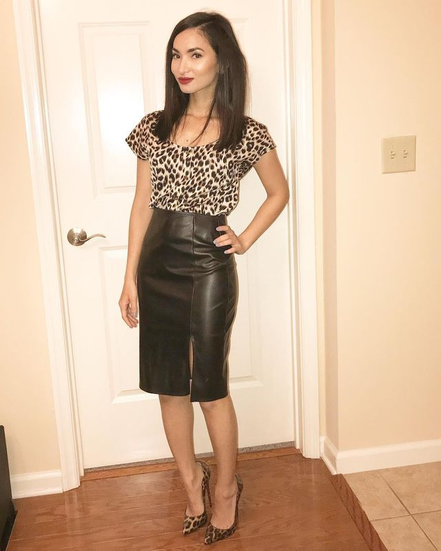 Black leather outfit with a leopard print for the top and shoes