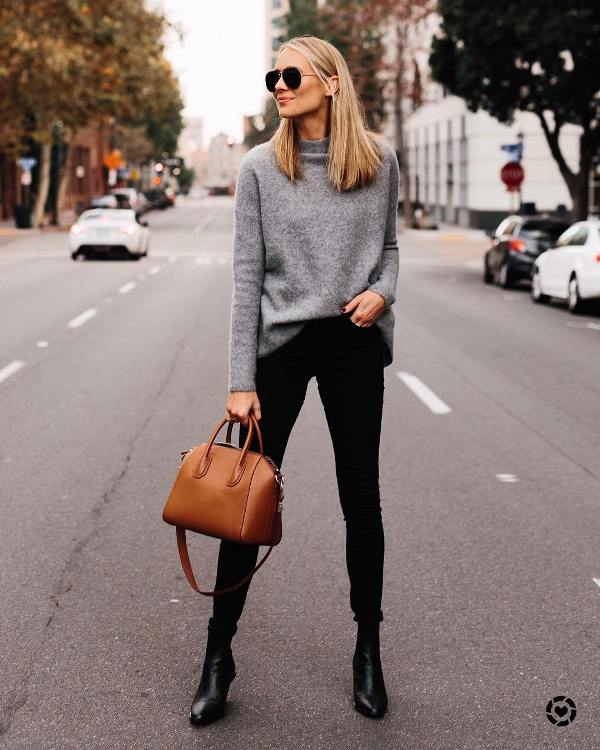 How to wear black skinny jeans with black boots and a gray sweater