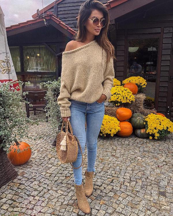 How to wear blue skinny jeans with ankle boots and an off shoulder sweater
