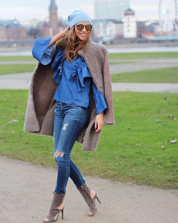 A beautiful outfit with blue skinny jeans and a jeans blouse