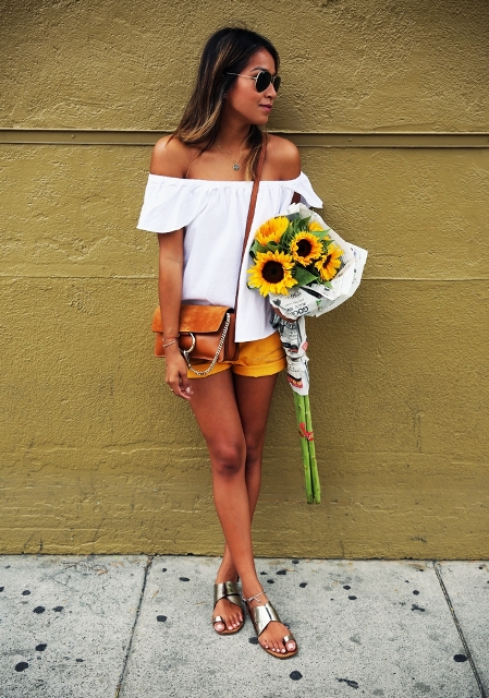 Light white breezy blouse and a pair of short shorts