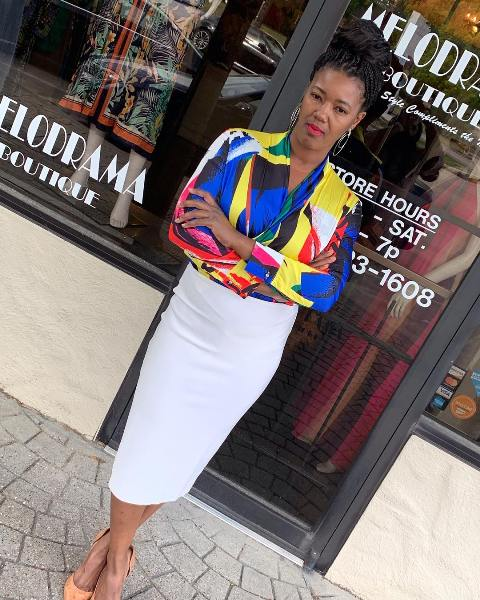 White pencil skirt with a multi color shirt