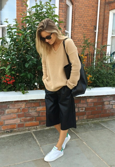 Black culottes outfit with leather pants and white sneakers