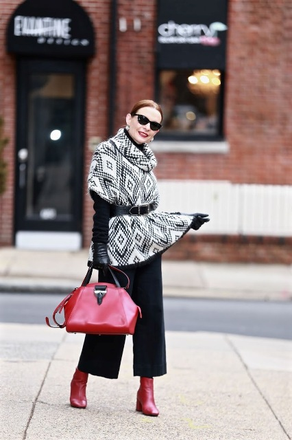 Black culottes pants outfit with red boots